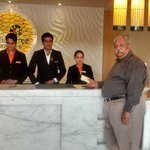 Smiling staff at reception