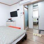 room amenities, wardrobe (w/ mirror), toilet (glass door)
