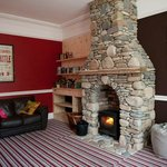 Cosy communal lounge with wood burner