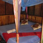 Our double bed with a mosquito net above
