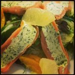 Smoked salmon roll stuffed with wild garlic and goat cheese  served with citrus salad