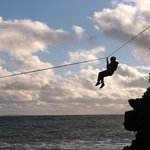 Zip lines across zawns on the sea cliffs
