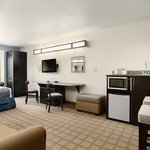 Spacious Queen Suites feature a Wet Bar with Microwave & Mini-Fridge