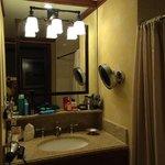 Please note the makeup mirror. Enough storage;granite sink. Very nice.