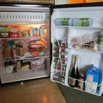 Spacious mini fridge, had bottle water in collapsable cooler I filled daily with ice