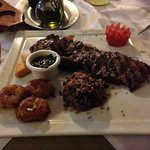 Perfectly cooked Churrasco Maya (steak, gallo pinto, queso frito, and fried plantains)