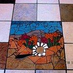 Handmade mosiac artwork is featured in the tile floor.