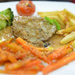 Miam ! Our roasted pork with french fries and vegetables...