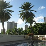 View from a lounge chair by the pool of the Luana Waikiki hotel.