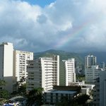 A rainbow over the mountains from a studio with kitchen on the 8th floor at the Luana Waikiki Ho