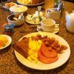 Coffee or tea, Fresh cut fruit, yogurt, eggs, potatoes, toast (white, wheat, multi-grain or sour