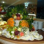 Very clever work on buffet table with varios fruits and veg.