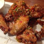 Spicy Calabrian Wings:  tossed with garlic and chile peppers served w/gorgonzola dipping sauce