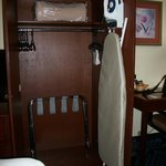 Armoire with iron, board, blanket & luggage rack