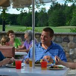 Outdoor dining with a view of the golf course