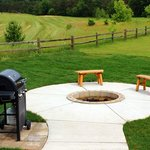 Beautiful fire pit off the back porch on hole number one