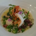 Moreton Bay Bug, prawn, clams, squid, fregola, jamon, green peas & chives