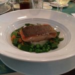 salmon on a bed of peas and mashed potatoes