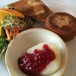 baked camembert, toast points, lingonberry sauce in pear