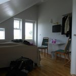One of the upstairs rooms. There is a deck and stairs down outside the door.