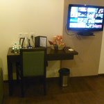 Desk, chair, snacks, coffee/tea maker and flat screen TV