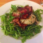 Chicken breast on a lot of rocket!