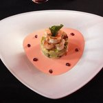 Shrimp and avocado appetizer in a passion fruit sauce
