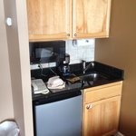 Kitchenette in studio. Contains dish washing liquid, silverware, plates/cups, can opener, coffee