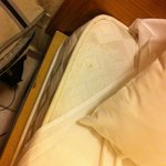 Thin badly laundered bedding un ironed and stained