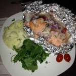 Steamed salmon topped with fresh seafood