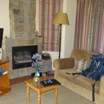 There is a nice settee, TV with DVD Player and a Fireplace