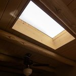 Charming beamed ceiling with skylight.