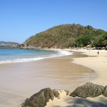 The beach with Ixtapa beyond the hill