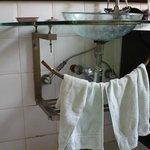 The basin (minus plug) and broken towel rail