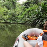On the Rio Ernesto, using the rentable inflatable boat.