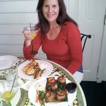 Enjoying a Basil martini, bacon wrapped scallops on a cedar plank and broiled seafood.All fabulo