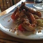 Grilled Kaui prawns on a green papya salad w/ nuoc cham
