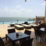 Beautiful pool and pool bar overlooking ocean