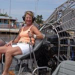 my wife sitting on the air boat