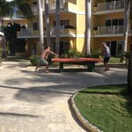 Pool side ping-pong.  rooms in the background