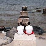 Boys enjoying the ocean view.