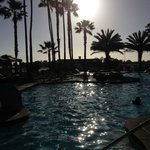 view of the pool at sunset plus their are two hot tubs !!