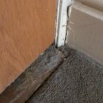 Disgusting pile if old dust & dirt around the edge of skirting and door.