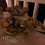 Antipasti misti di mare: polipo alla insalata, alici marinate e pesce sfilettato