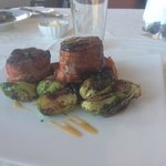 Bacon wrapped pork tenderloin, brussel sprouts, and sweet potatoes