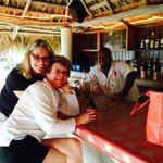 """The Hut Bar and """"Yeng"""" our bartender on the beach"""
