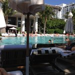 View from the beach side of the pool upon the hotel and pool