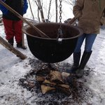 Boiling down maple sap into syrup