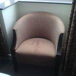 Torn, damp chair