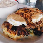 Braised Pork Shoulder and Collared Green Egg Benedict Topped with a Rich Onion Gravy and Hashbro